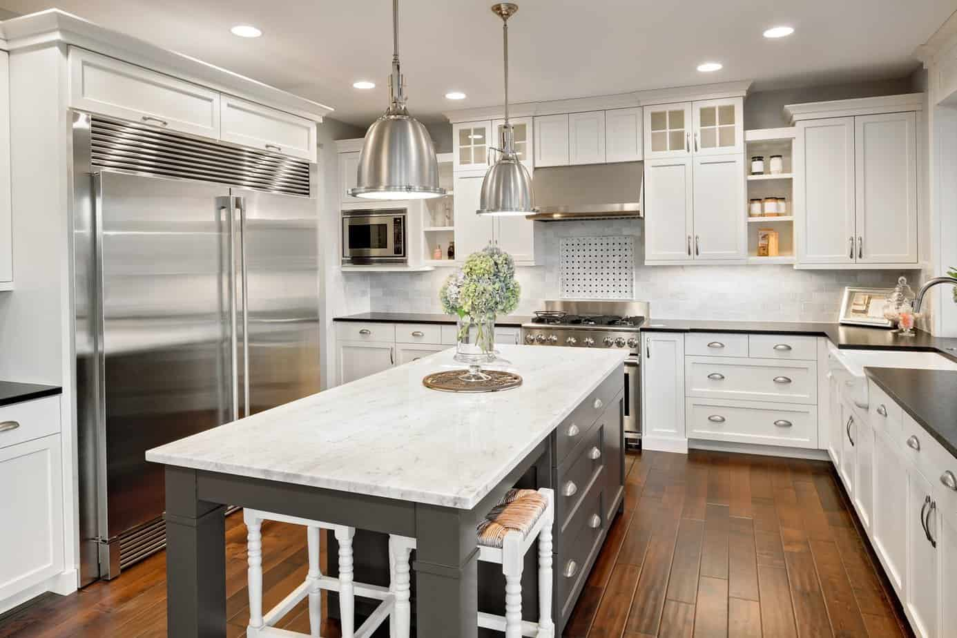 Residential kitchen in white with new recessed can lights. Electrician Amherst NY under cabinet lighting